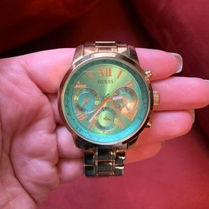 Teal face gold Guess watch